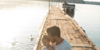 man and girl sitting on brown dock near boat and two white ducks during daytime - Администрация г.Лысьва